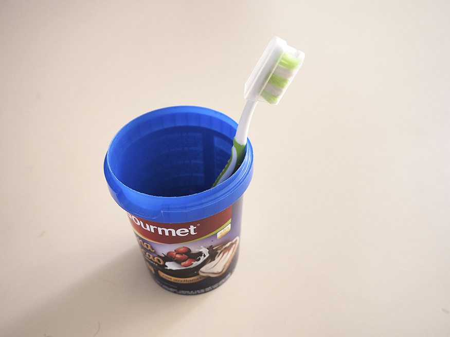 toothbrush and small bucket